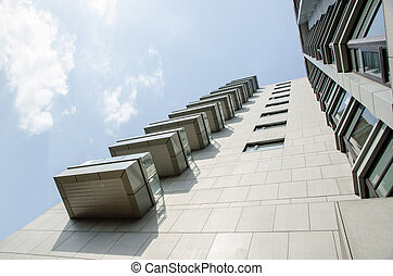 Modern Building with blue sky and white cloud