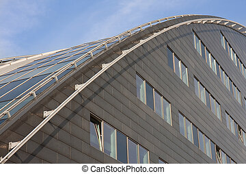 Modern building with curved roof of glass