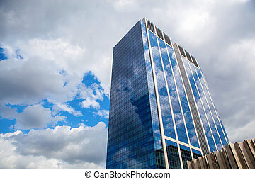 Modern building with reflection of blue sky