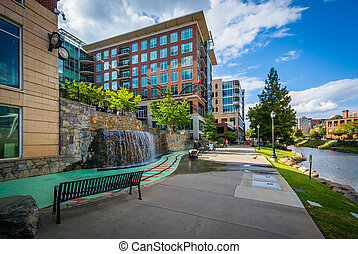 Modern buildings and walkway along the Reedy River, in downtown Greenville, South Carolina.