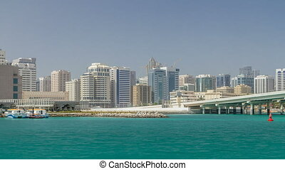 Modern buildings in Abu Dhabi skyline timelapse with mall...