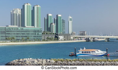Modern buildings in Abu Dhabi skyline timelapse with...