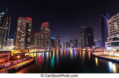 Modern buildings in Dubai Marina, Dubai, UAE at night