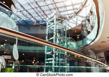 Modern buildings. Shopping center interior design. High tech architecture. Close-up of handrail. Roof and elevator