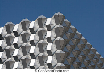 Modern business building. Fragment of a facade against the clear blue sky. Dresden, Germany.