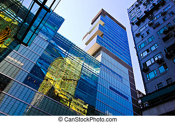 modern business building with reflection of the building.