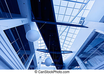 Modern business interior with glass ceiling in blue tones