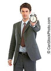 Modern business man showing alarm clock