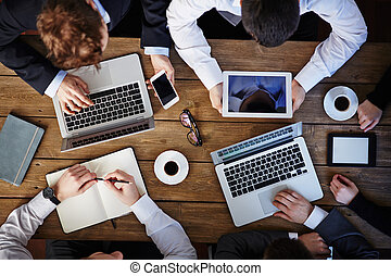 Modern business meeting - Group of business people using...