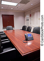 Modern Business Phone on Old Fashioned Conference Table