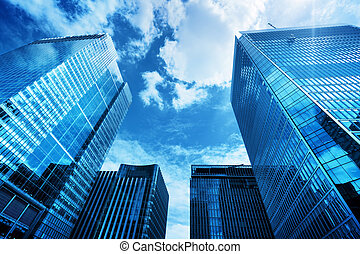 Modern business skyscrapers, high-rise buildings, architecture raising to the sky, sun