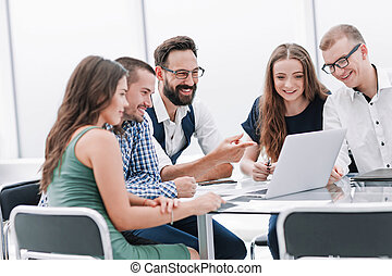modern business team discussing online news in the office