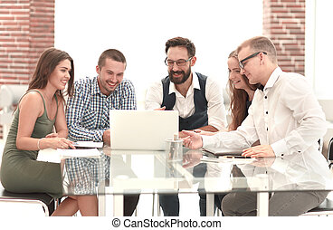 modern business team using a laptop in the workplace