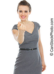 Modern business woman beckoning with finger