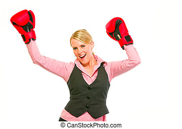 Modern business woman in boxing gloves celebrating victory