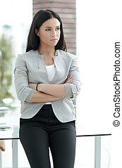 modern business woman near the window in the office