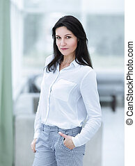 modern business woman on blurred background office
