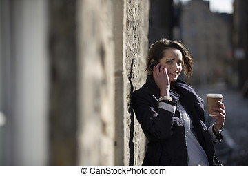 Modern Business woman, talking on mobile phone outside. -...