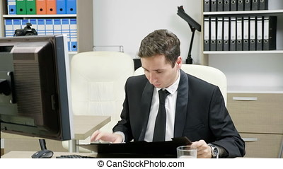 Modern businessman in office typing at the computer