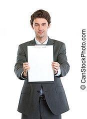 Modern businessman showing blank clipboard