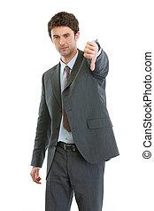 Modern businessman showing thumbs down