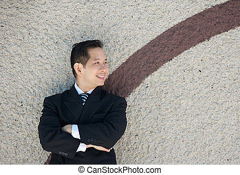 Modern businessman smiling outdoors