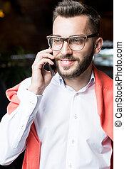 Modern Businessman Speaking by Phone