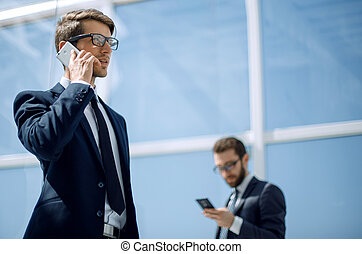 modern businessman talking on a mobile phone