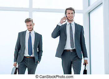 modern businessman walking down the office hall. photo with copy space