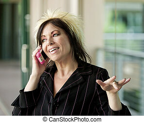 Modern Businesswoman on a Cell Phone