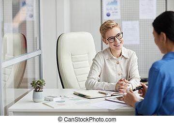 Modern Businesswoman Talking to Worker