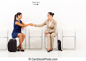 businesswomen greeting each other before the interview