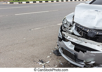 Modern car accident involving two cars on the road