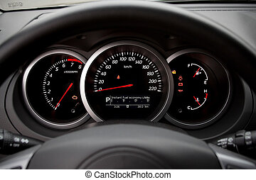 Modern car dashboard closeup with glowing arrows