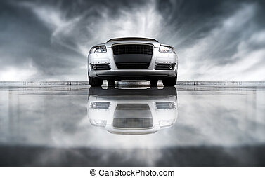 Modern car front view. On sky background and with reflection.