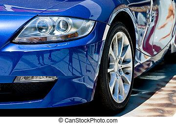 modern car in reflections on blue metallic