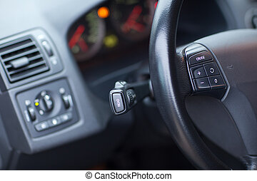 Modern car interior - detail of the steering wheel (shallow ...