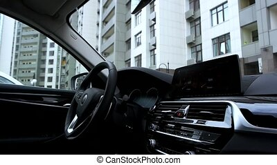 Modern car interior in the city