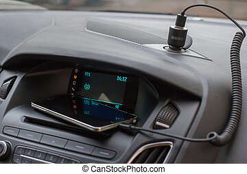 Modern car interior with smart phone