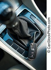 Modern Car Keys Laying Near Manual Transmission Stick Shift....