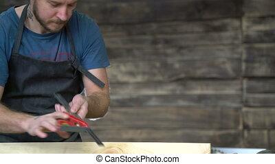 modern carpenter at work in his workshop