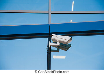 Modern CCTV camera. Concept of surveillance and monitoring.