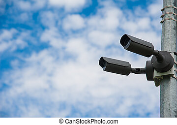 Modern CCTV camera. Concept of surveillance and monitoring