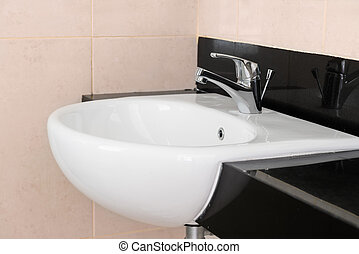 Modern ceramic hand wash basin with chrome water mixer tap...