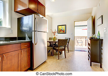 Modern cherry kitchen with steal appliances.
