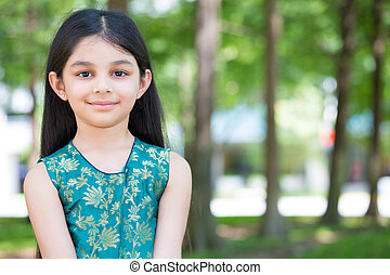 Modern child - Closeup portrait, young girl standing in ...
