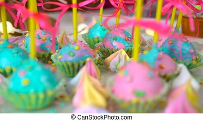 Modern children's birthday party. Unicorn themed treats, close-up against colorful background.
