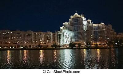 Modern city building on river emban