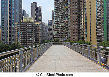 Modern city buildings background with empty road floor -...