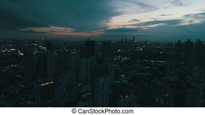 Modern city during beautiful cloudy sunset